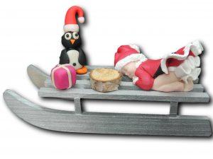 traineau bébé mère noël pingouin cadeau rose