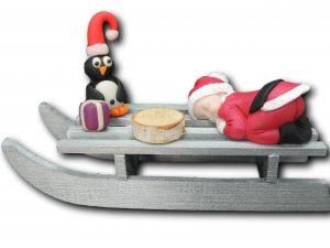 traineau bébé père noël pingouin cadeau violet